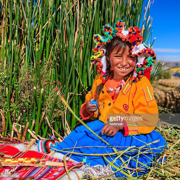 Little girl on Uros floating island selling souvenirs, Lake Tititcaca