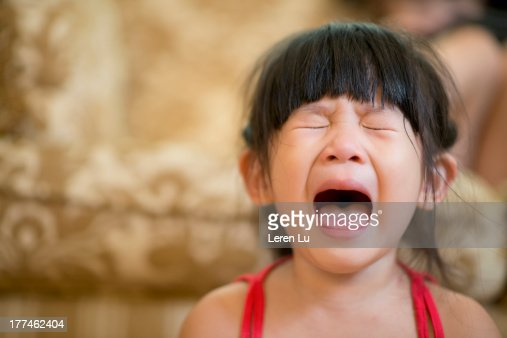 Little Girl Opening Mouth And Crying Hysterically High-Res -6439