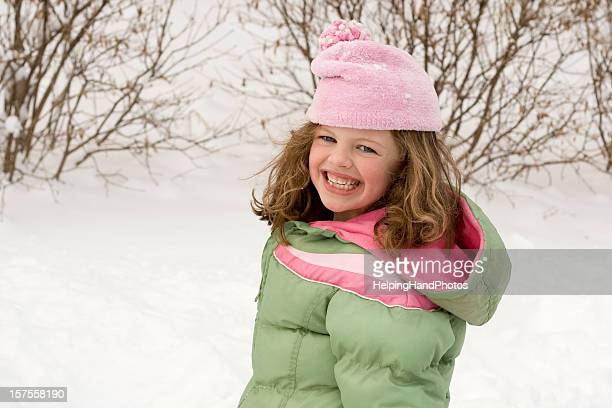 little girl outdoors in winter - green coat stock pictures, royalty-free photos & images