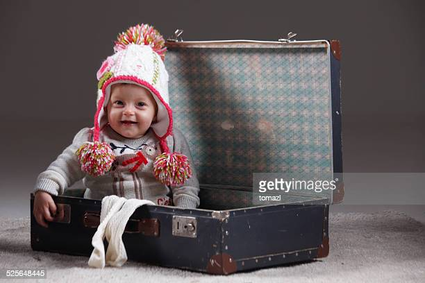 Little girl packing for travel