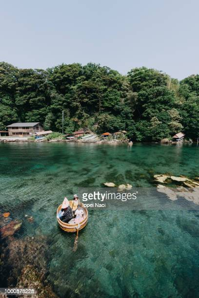 Little girl paddling traditional boat of Sado Island, Niigata, Japan