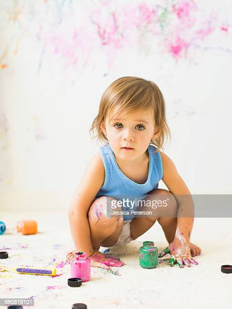 little girl (2-3) painting on carpet - little girls undies stock pictures, royalty-free photos & images