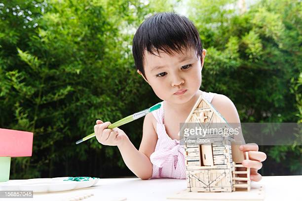 little girl painting - bamboo material stock photos and pictures