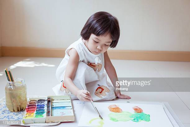 Little girl painting water collor