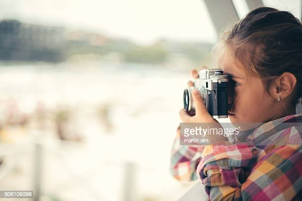 Little girl photographing the beach