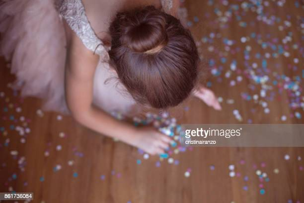 Little girl pick up confetti