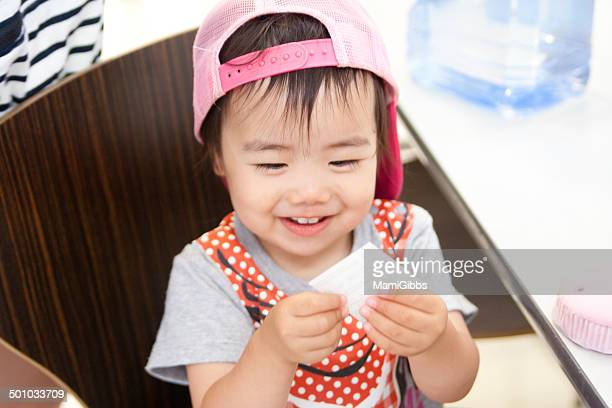 little girl play toy and smiling - mamigibbs stock photos and pictures
