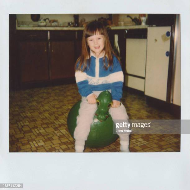 little girl playing, 1980s child, vintage childhood photograph - 1980 1989 stock pictures, royalty-free photos & images