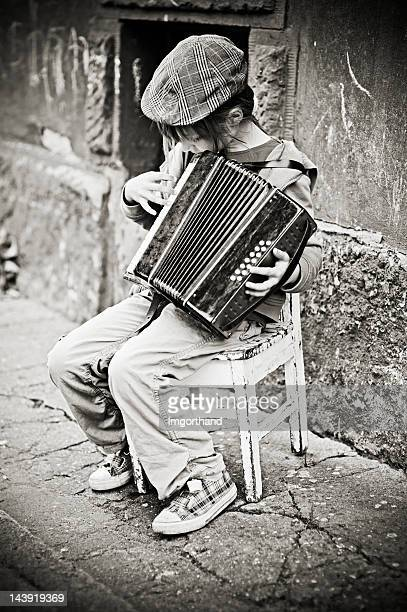 Little girl playing accordion