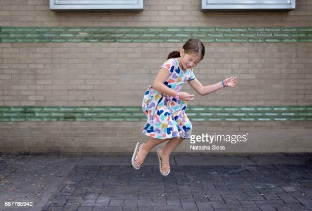 Little girl playing air guitar in mid air