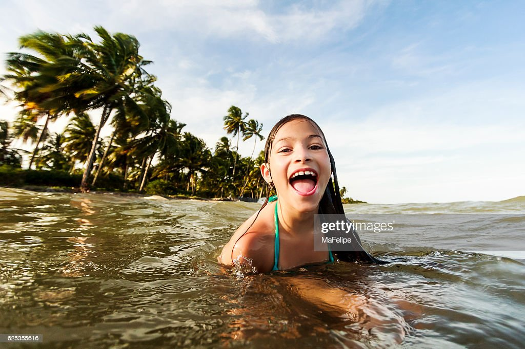 Little Girl Playing at Sea in Tropical Beach : Stock Photo