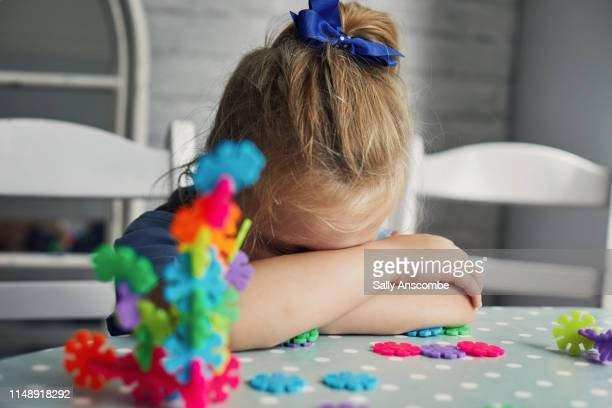 little girl playing building with shapes - preschool child stock pictures, royalty-free photos & images