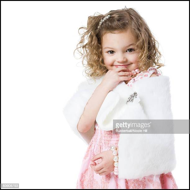 little girl playing dress up