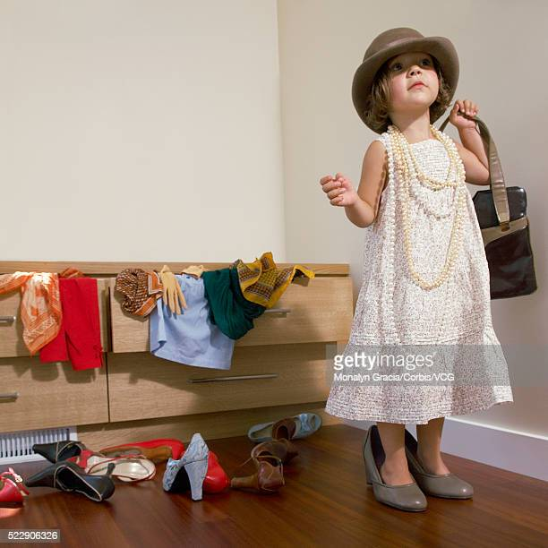 Little girl playing dress-up