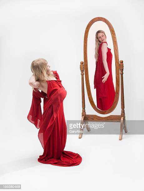 "little girl playing dress-up/sees ""all  grown up"" reflection in mirror - full length mirror stock photos and pictures"