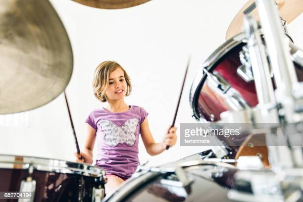 little girl playing drums - drum kit stock photos and pictures