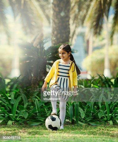 Little Girl Playing Football