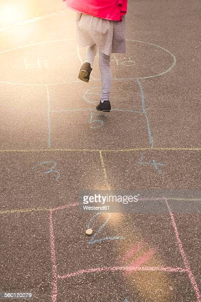 little girl playing hopscotch - hopscotch stock pictures, royalty-free photos & images