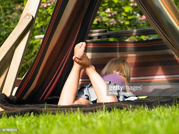 little girl playing in a tent - barefoot feet up lying down girl stock photos and pictures