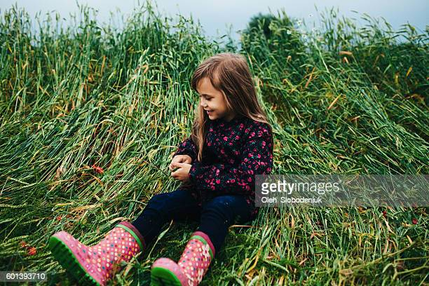 Little girl playing in grass