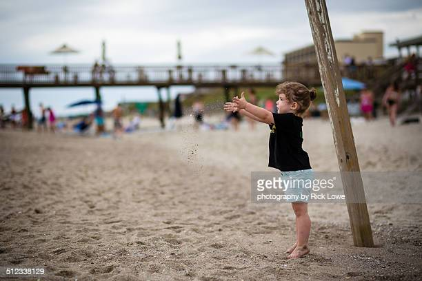 little girl playing in the sand at the beach - atlantic beach north carolina stock pictures, royalty-free photos & images