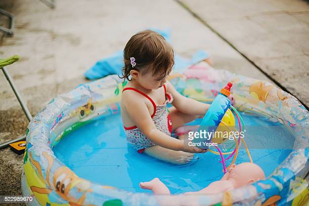 little girl playing in wading pool