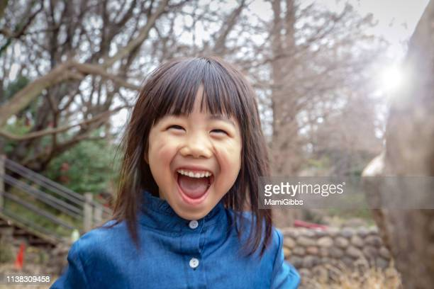 little girl playing on park - childhood stock pictures, royalty-free photos & images