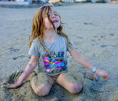 little girl playing beach