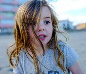 little girl playing beach