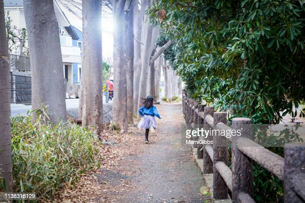 little girl playing on the park - 神奈川県 ストックフォトと画像
