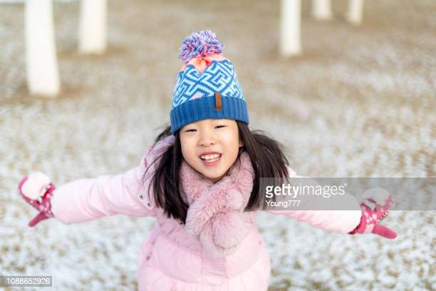 little girl playing on the snow - asia pac stock pictures, royalty-free photos & images