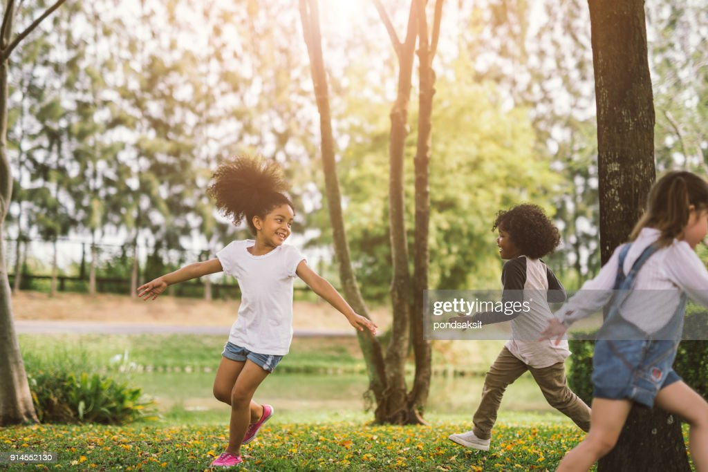 little girl playing outdoor : Stock Photo