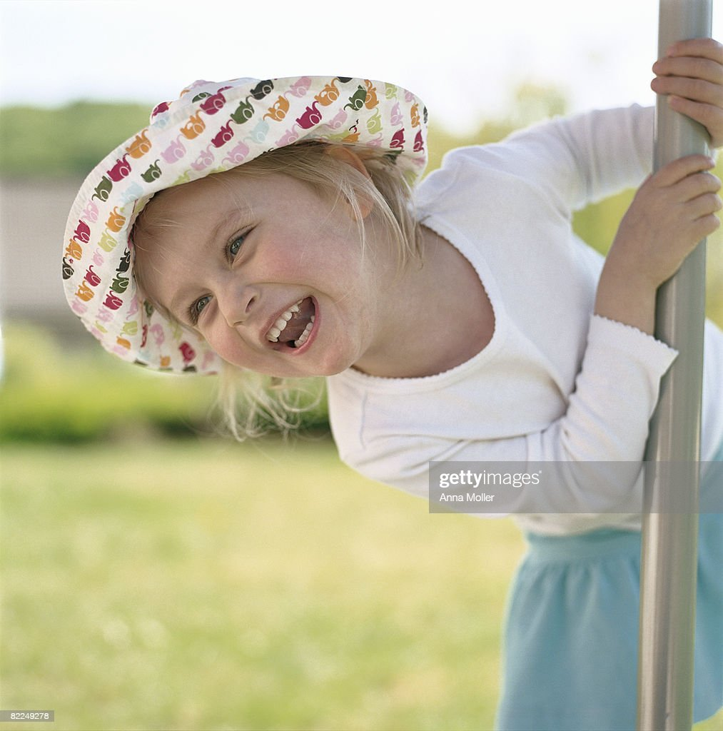 Little girl playing outside : Stock Photo