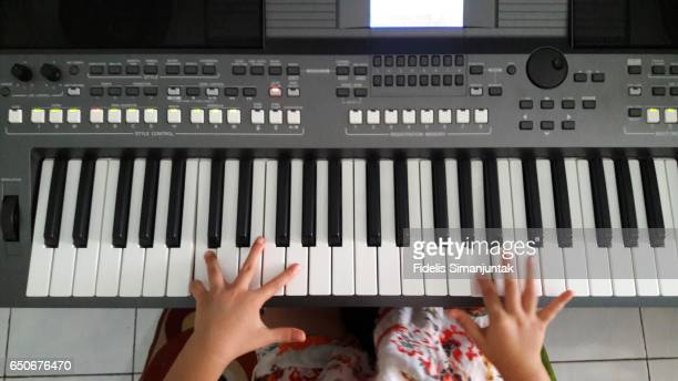 Little girl playing piano (hand only)