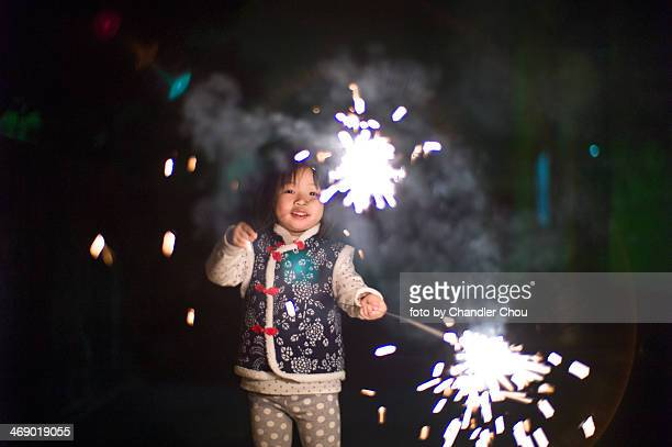 little girl playing sparklers