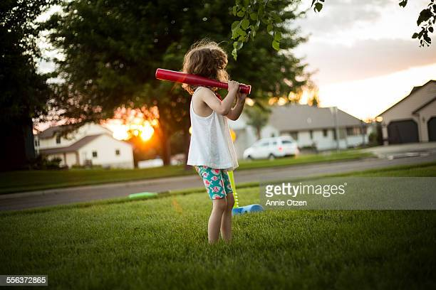 Little girl playing tee ball