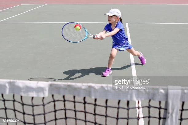 little girl playing tennis - sporting term stock pictures, royalty-free photos & images