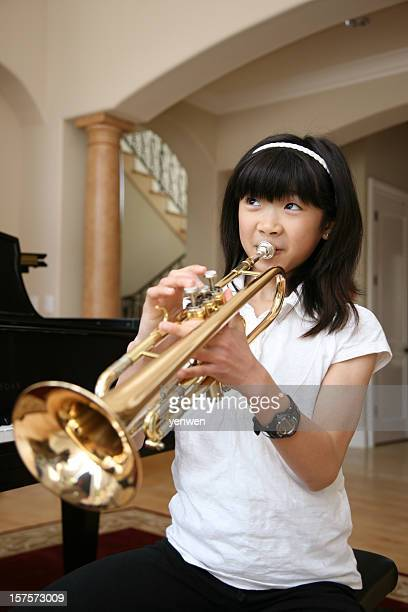 Little Girl Playing Trumpet