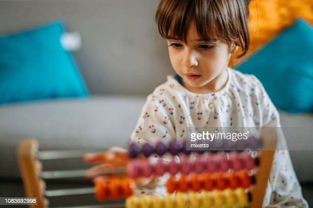 little girl playing with abacus - counting stock pictures, royalty-free photos & images