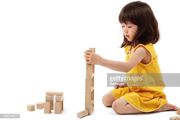 little girl playing with building blocks - isolated - blokken stockfoto's en -beelden