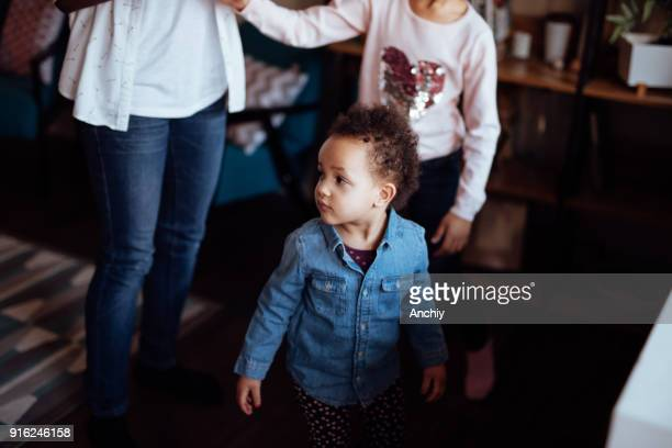 little girl playing with her mom and sister - interracial cartoon stock photos and pictures