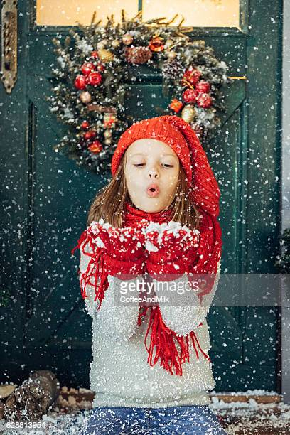 little girl playing with snow - vertical stock pictures, royalty-free photos & images