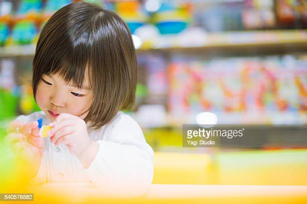 little girl playing with toys. - nursery school building stock pictures, royalty-free photos & images