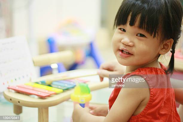 Little girl playing xylophone