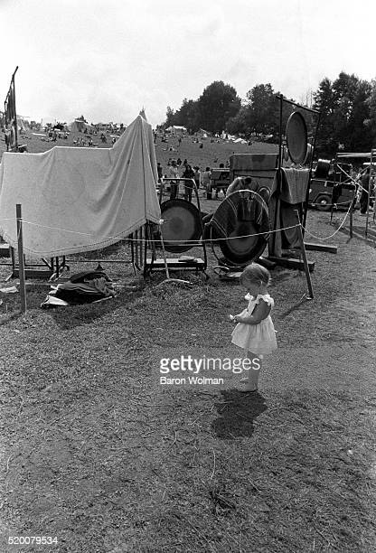 A little girl plays amongs gongs at the Woodstock Music Art Fair Bethel NY August 15 1969