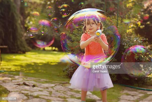 little girl plays  bubbles