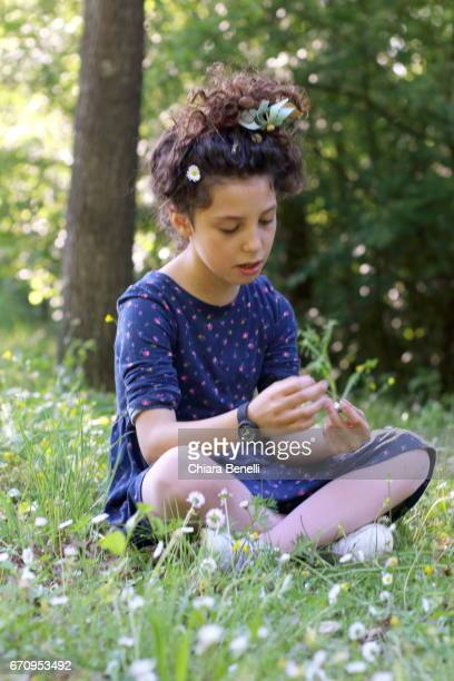 Little girl plays in nature