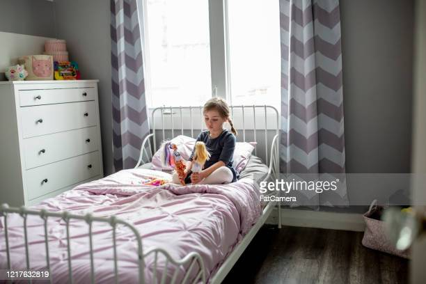 little girl plays on her bed. - fatcamera stock pictures, royalty-free photos & images