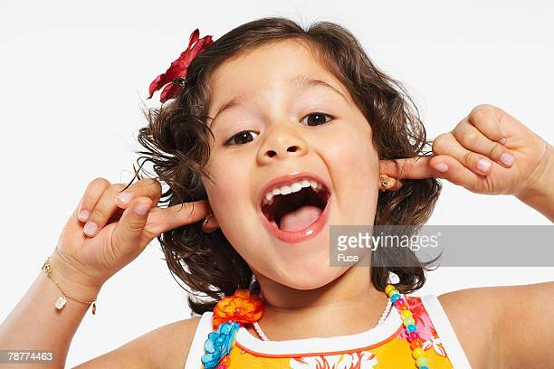 little girl plugging her ears - fingers in ears stock pictures, royalty-free photos & images