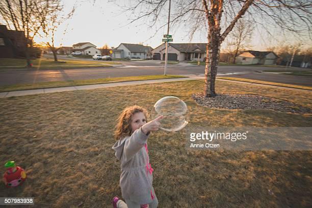 Little Girl Popping Bubble